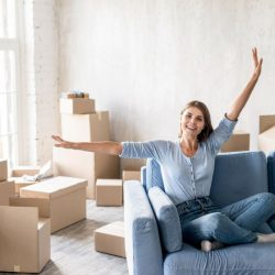 front-view-woman-couch-happy-about-moving-out (3)